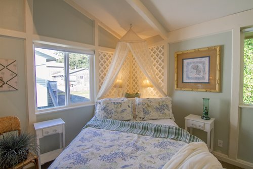 The canopy in the queen bedroom upstairs adds a bit of  whimsey.