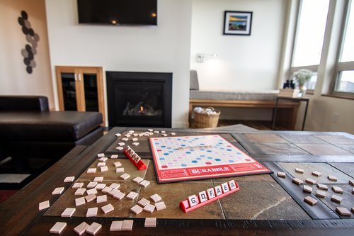 Pick out a game and sit by the fire for family game night.