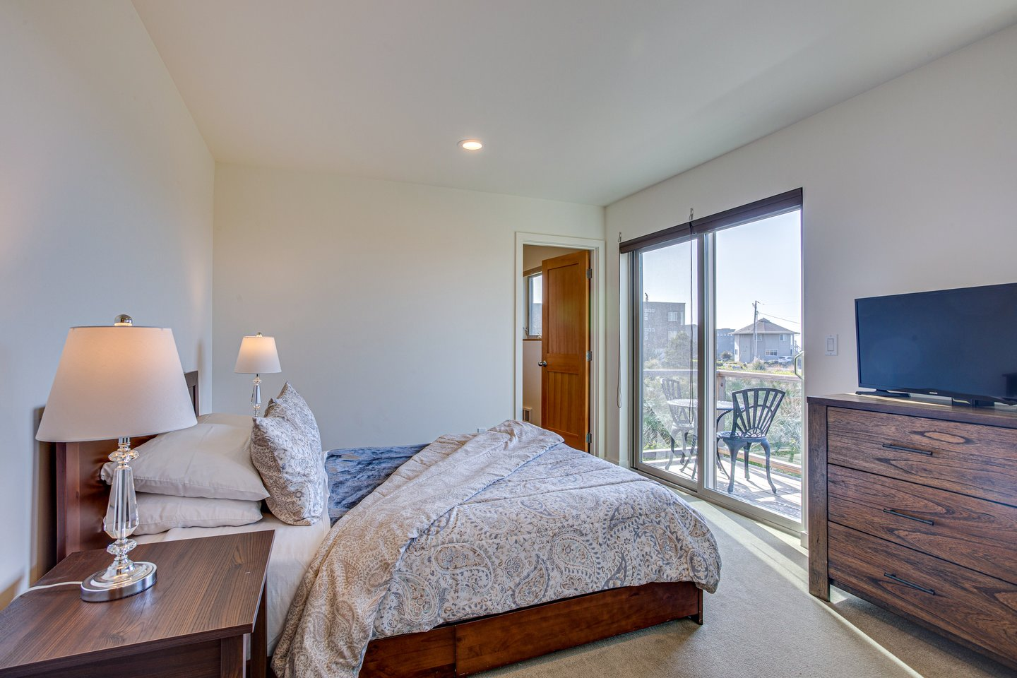 Cozy up in the queen bedroom with ocean views downstairs.