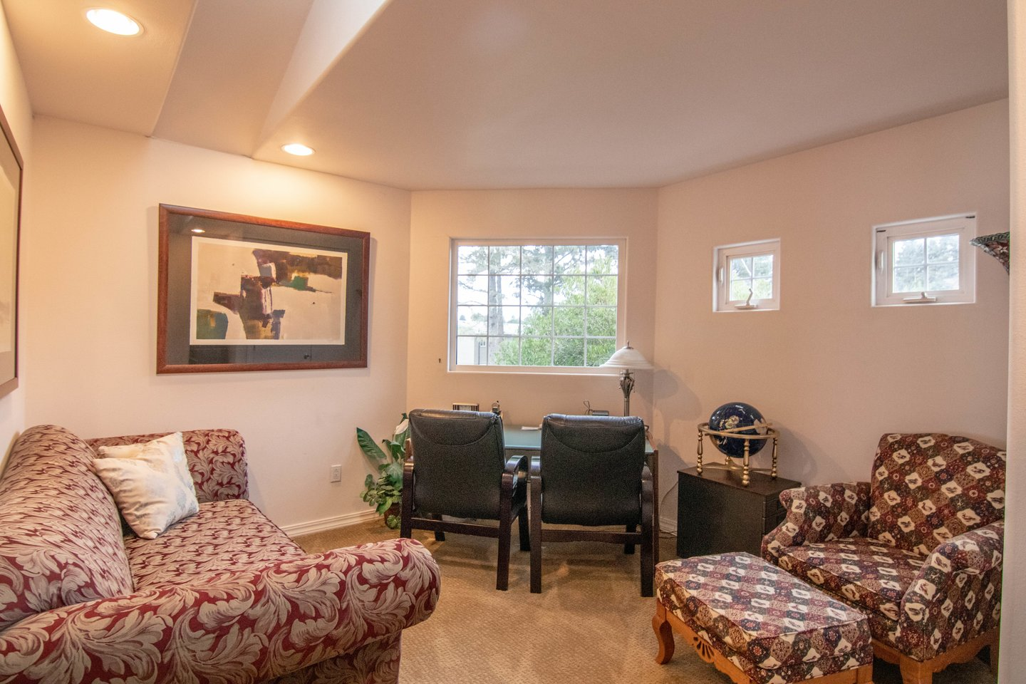 Attached to the master bedroom is a sitting room for work or relaxation.