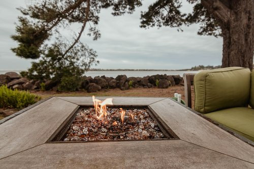 The fire pit adds some warmth to watching the coastal scene!