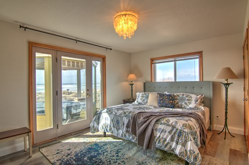 Enjoy the master bedroom with the hot tub just steps away.