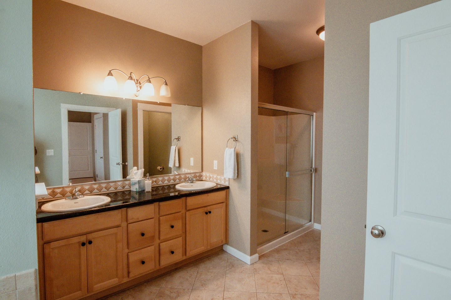 The double vanity and walk in shower is very spacious.